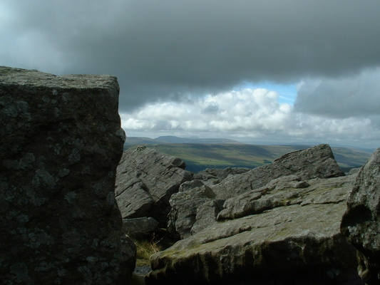 View from Great Whernside summit with Pen-y-ghent, Ingleborough and Whernside in the distance