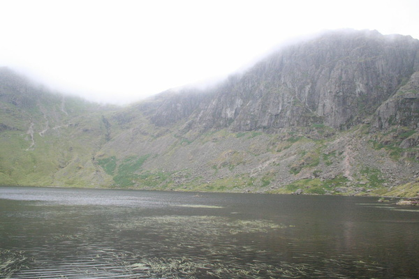 Stickle Tarn with Harrison Pike and Pavey Ark in low cloud behind