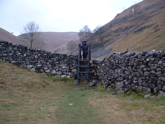 Heidi crossing last ladder stile on descent