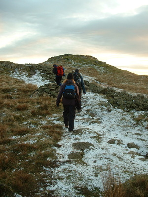 Final climb to Lord Crag as sun sets